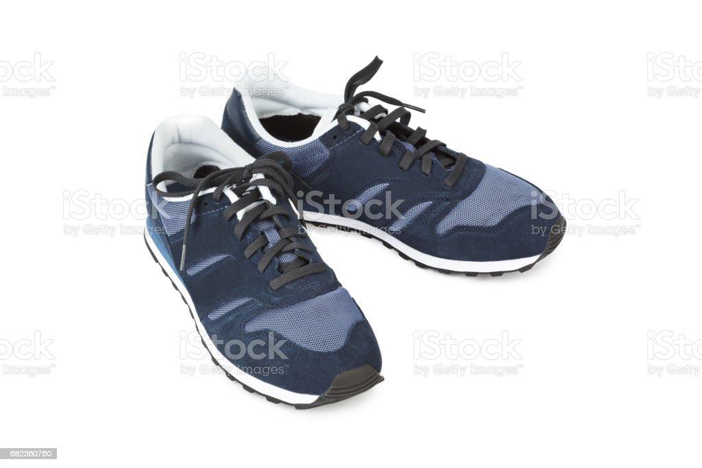 Blue sneakers royaltyfri bildbanksbilder