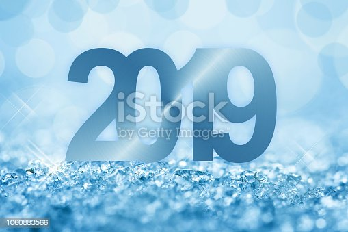 istock 2019 blue snow and bokeh lights greeting card 1060883566