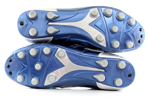 Blue Soccer (football) boots/shoes with 12 studs, isolated on white stock photo