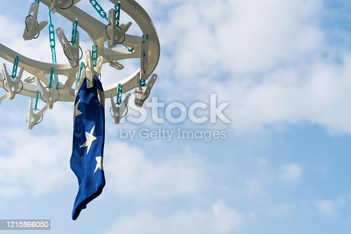 1146468292 istock photo Blue socks That was hung on the railing to expose the sun 1215866050