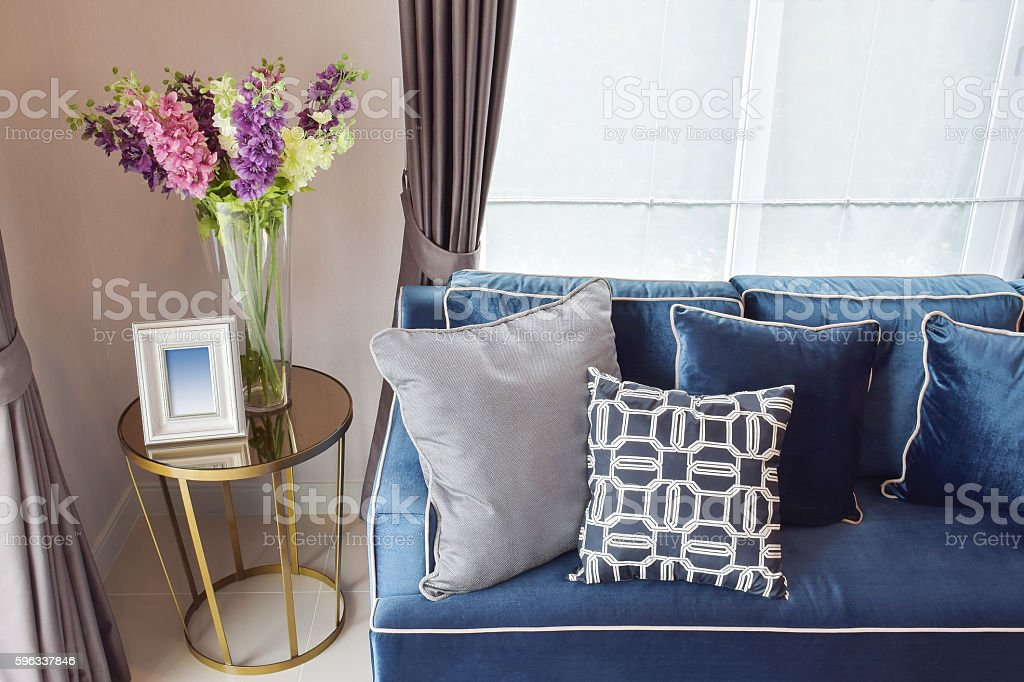 blue sofa and pillows with orchid vase in living corner Lizenzfreies stock-foto