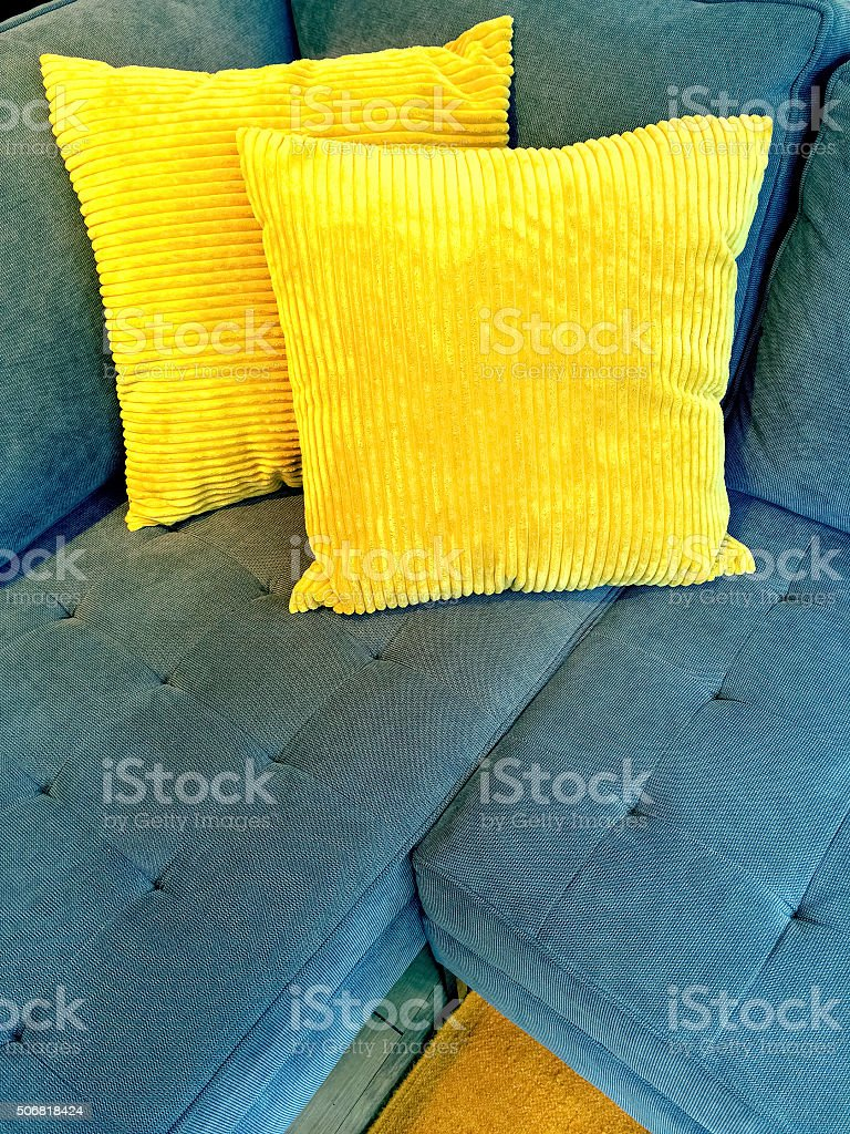 Blue Sofa With Bright Yellow Cushions Royalty Free Stock Photo