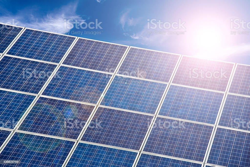 Blue solar cells, blue sky and sun halo bildbanksfoto