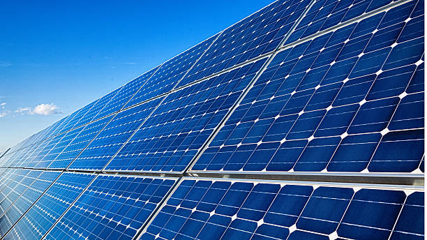 Blue solar panels in a row stock photo