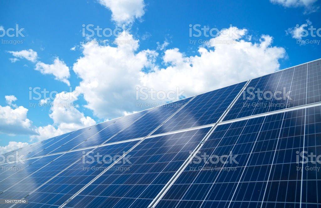 Blue solar panels over blue sky. Renewable energy. Blue solar panels over blue sky. Renewable energy. Biological Cell Stock Photo