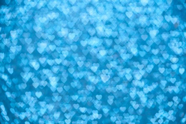 Blauen funkelnden Lichter der Herzen Hintergrund unscharf gestellt – Foto