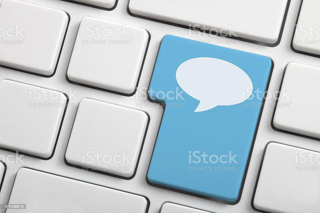 Blue speech bubble key on keyboard for social media concept stock photo
