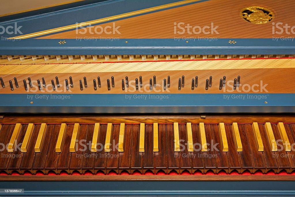 Blue spinet (harpsichord) with brown wooden keyboard royalty-free stock photo