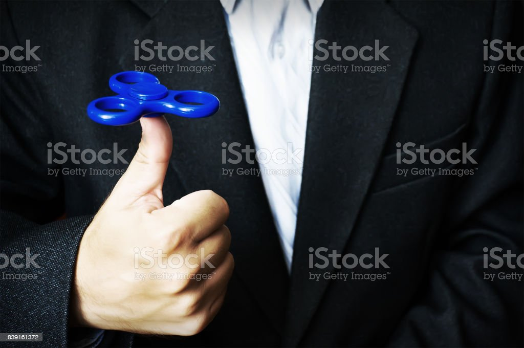 blue spinner in the hand of a man stock photo