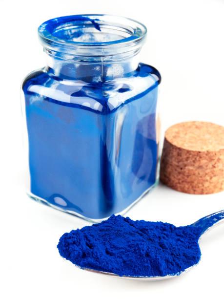 Blue Spirulina powder, isolated on white stock photo