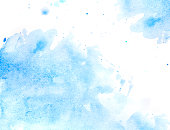 blue watercolor background with splashes on white watercolor paper. My own work.