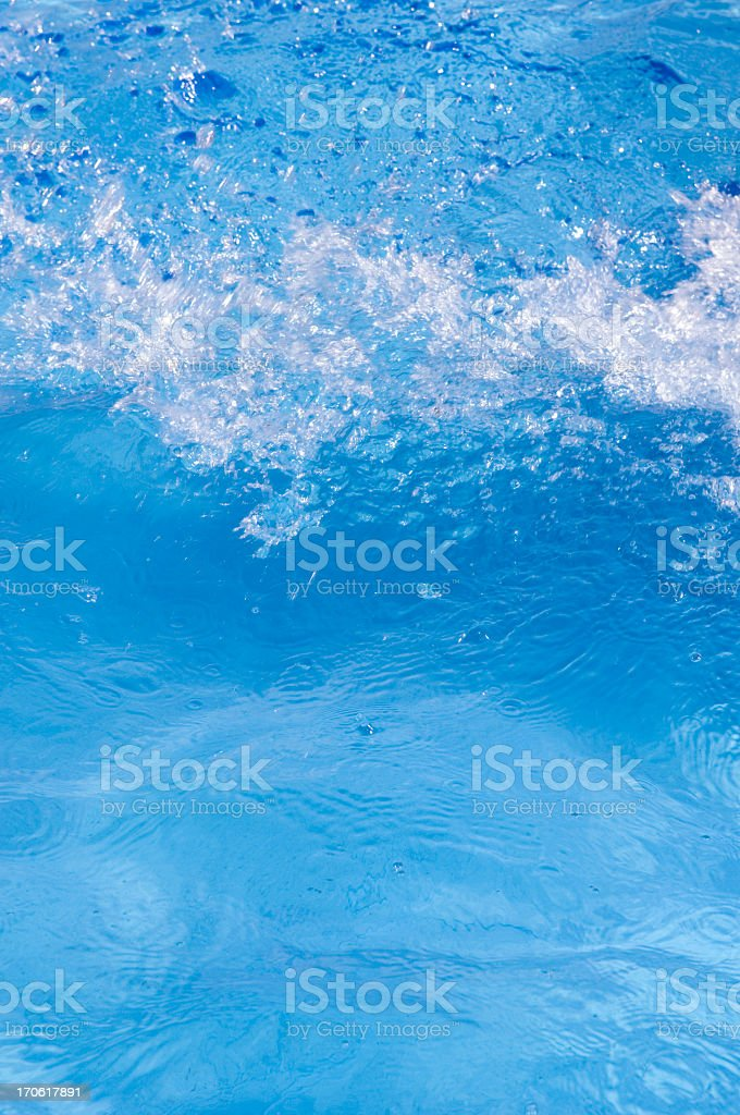 Blue splashing fresh water in pool stock photo