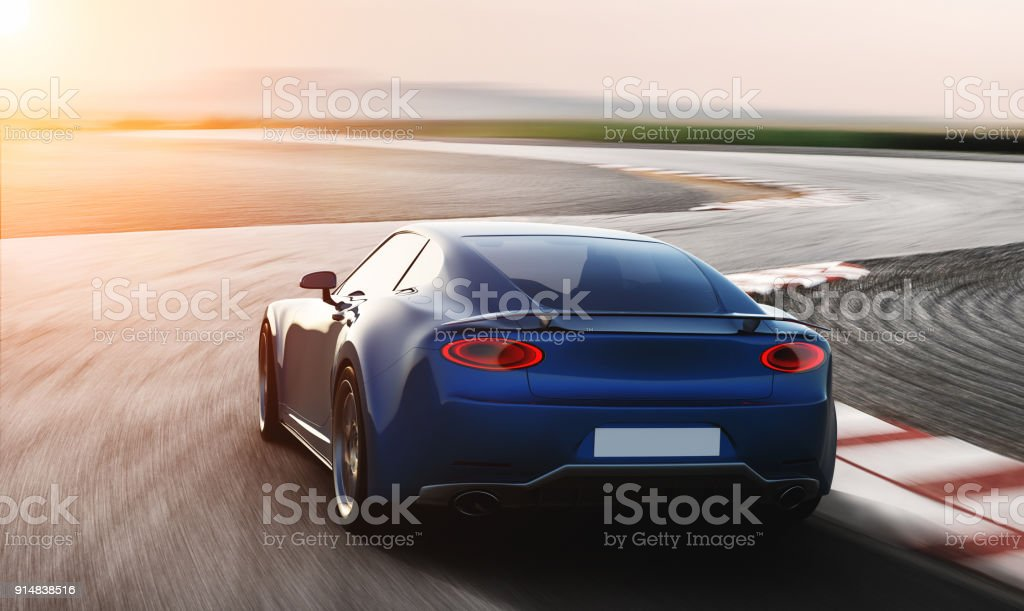 blue sports car driving on racetrack stock photo