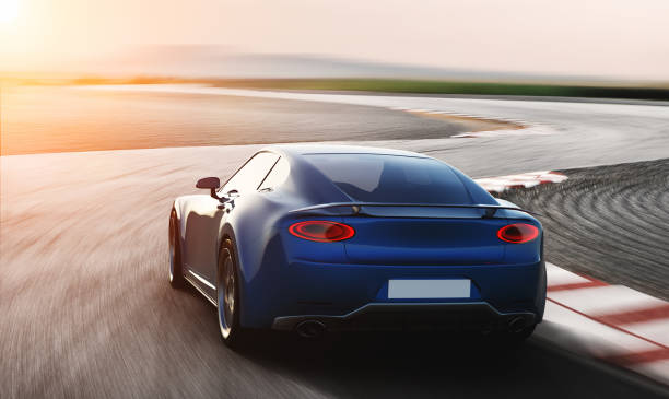 blue sports car driving on racetrack blue sports car driving on racetrack, photorealistic 3d render, generic design, non-branded sports car stock pictures, royalty-free photos & images