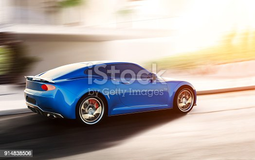 istock blue sports car driving on urban scene 914838506