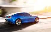 blue sports car driving on urban scene, photorealistic 3d render, generic design, non-branded