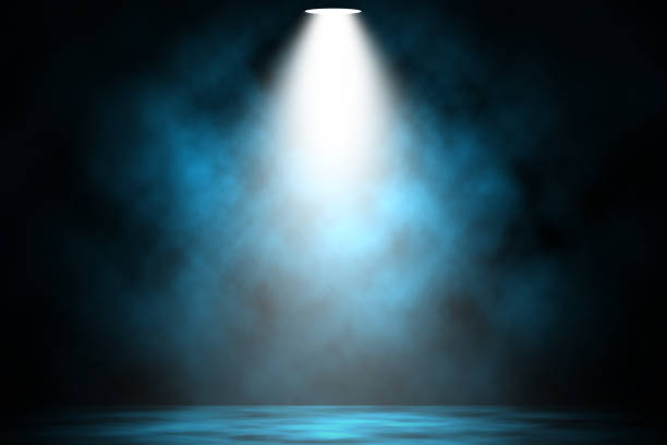 Blue spotlight smoke stage entertainment background. stock photo