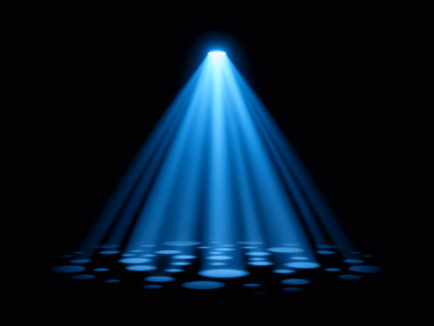 Blue spotlight with dot shapes on stage performance stock photo