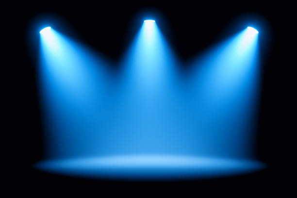 Blue spotlights on stage performance stock photo