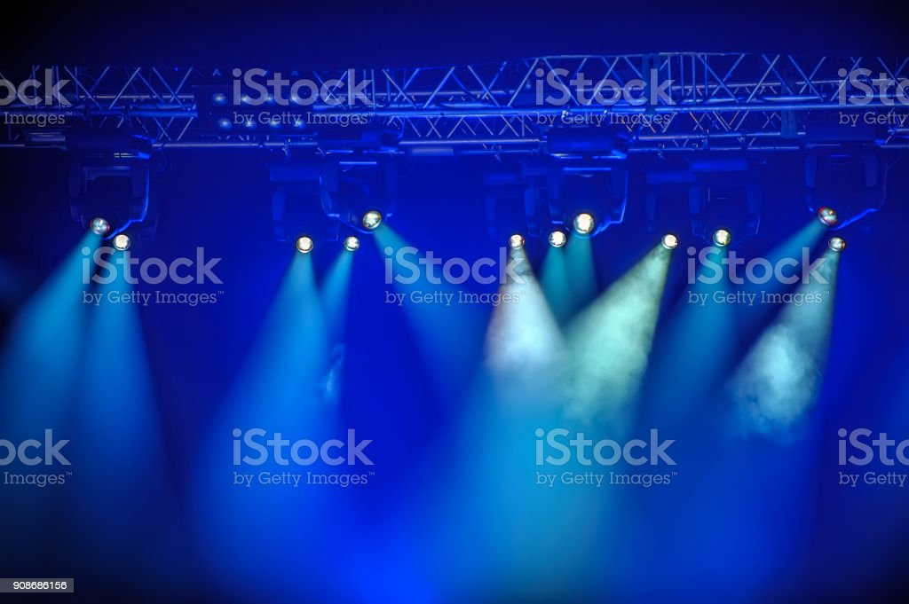 Blue spotlights on stage stock photo