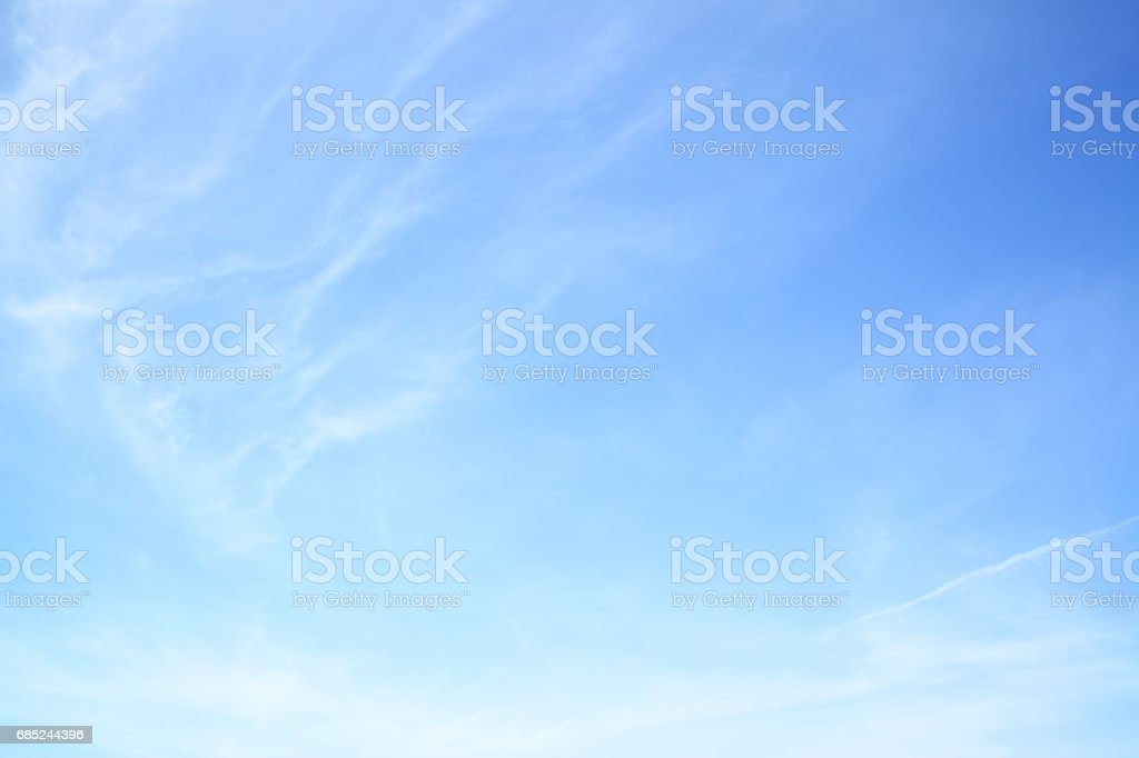Blue spring sky with light clouds stock photo