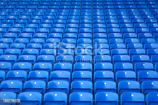 Multiple rows of spectator seating in a stadium.