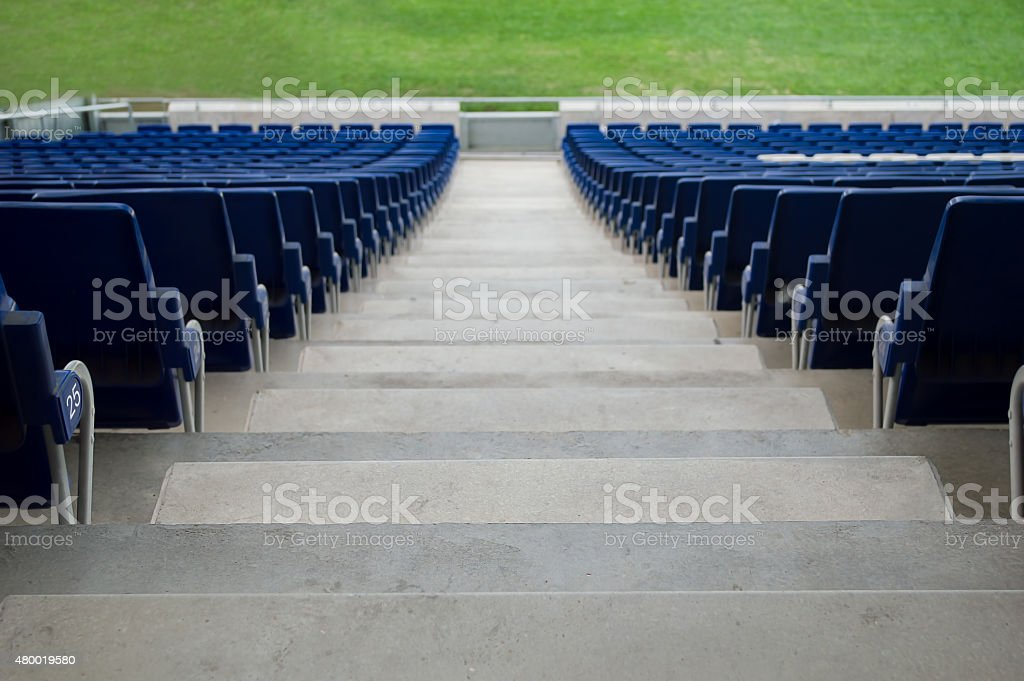 Blue stadium seats in a rear view stock photo