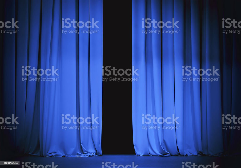 blue stage curtain slightly open stock photo