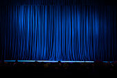 Blue stage curtains full frame.