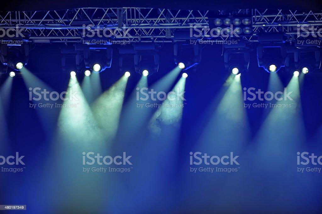 Blue stage spotlights stock photo