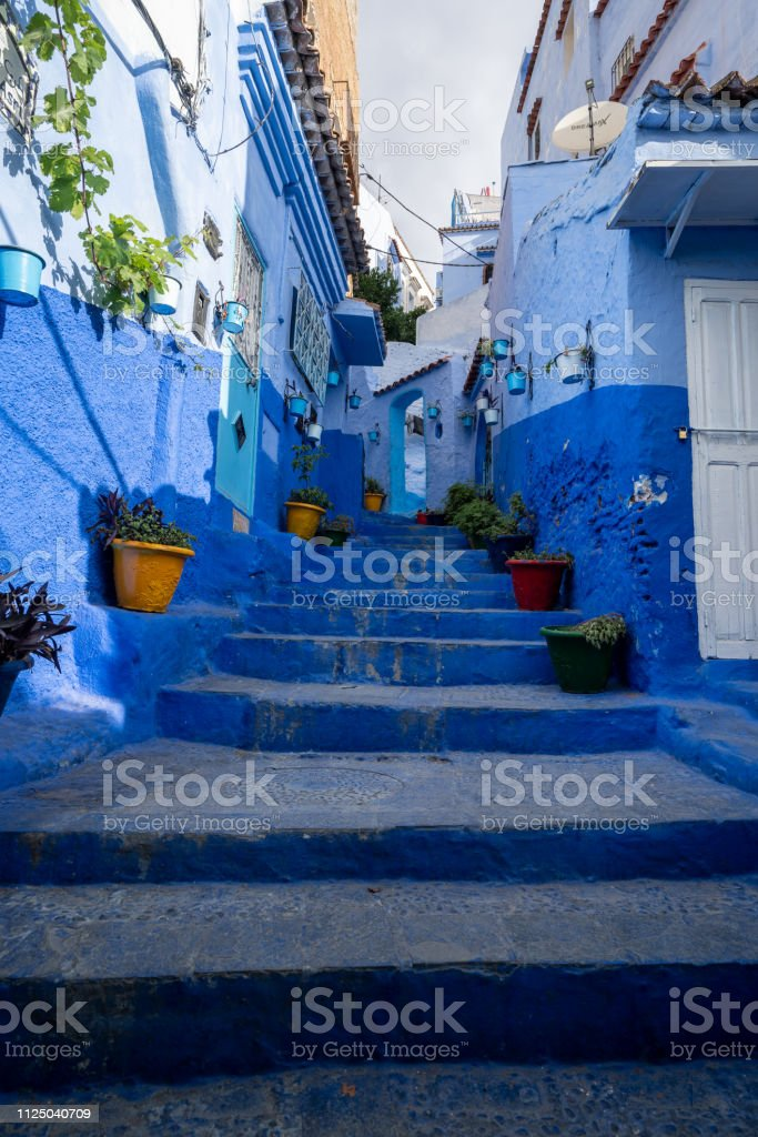 A blue staircase in the streets of Chefchaouen, Morocco stock photo