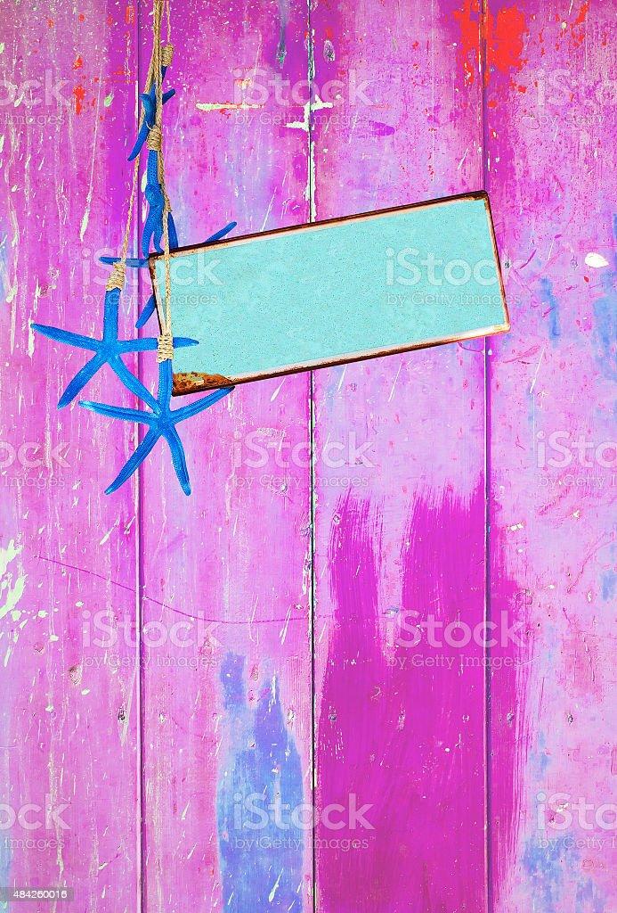 Estrela-do-mar azul turquesa e espaço na cor-de-rosa - foto de acervo
