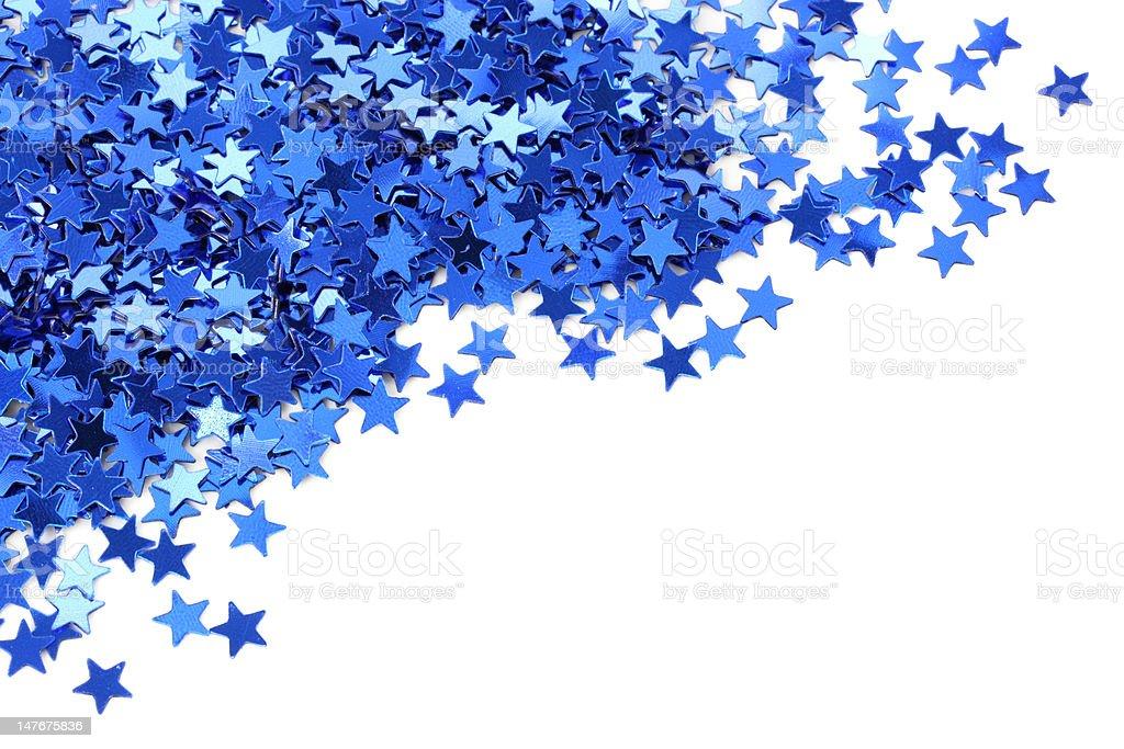 Blue stars confetti stock photo