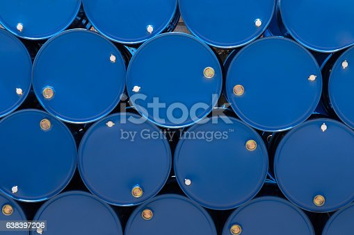 istock blue steel chemical tanks or oil tanks stacked in row. 638397206
