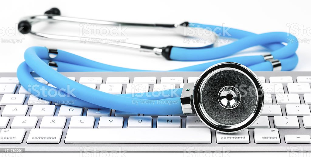 Blue stethoscope on computer keyboard royalty-free stock photo