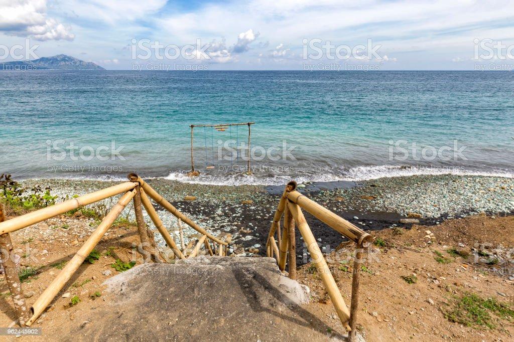 Blue stone beach and Savu Sea stock photo