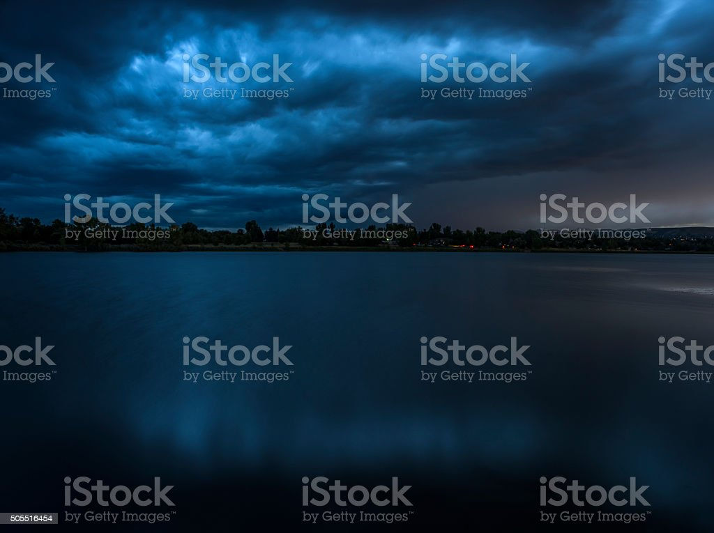 Blue Storm over Lake stock photo