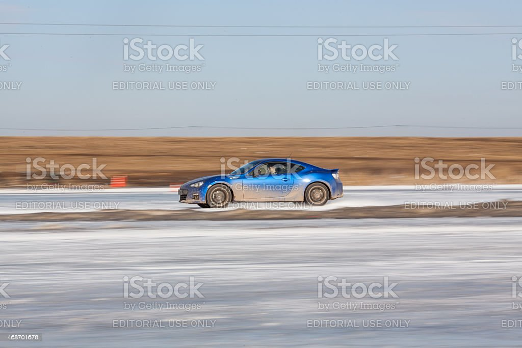 Blue subaru BRZ on ice track stock photo