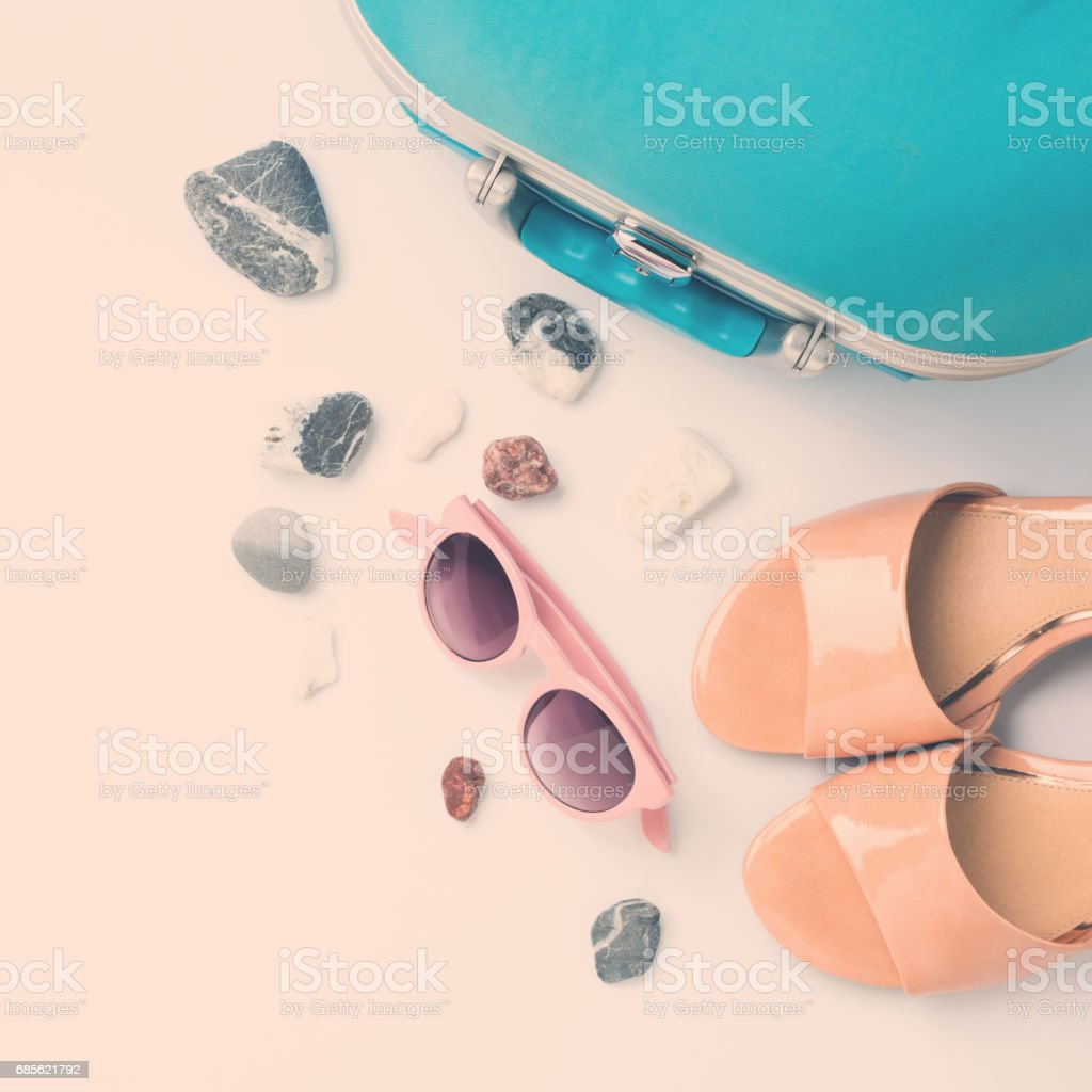 Blue suitcase, coconut, sandals, sun glasses royalty-free stock photo