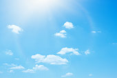 Blue summer sky and white soft clouds background
