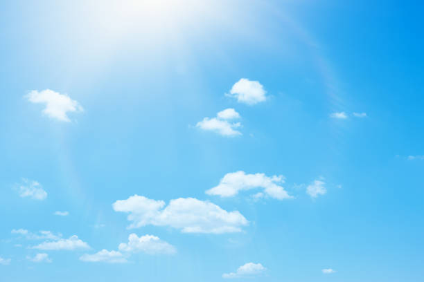 Blue summer sky and white soft clouds background stock photo