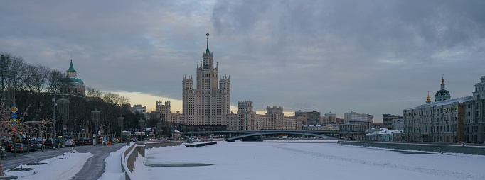 Moscow cityscape. Stalinist skyscraper on Kotelnicheskaya embankment, Bolshoy (Big) Ustinsky Bridge. Big traffic during coronavirus pandemic. Motorway is filled out by cars.