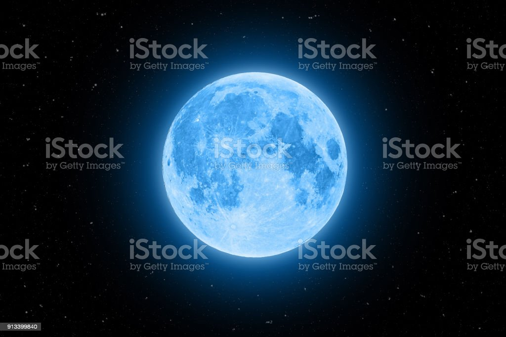 Blue super moon glowing with blue halo isolated on black background stock photo
