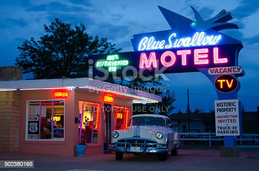 Tucumcari, United States - May 16, 2014: The Blue Swallow Motel is a legendary lodge along historic Route 66 in Tucumcari, New Mexico.  Its neon sign still touts