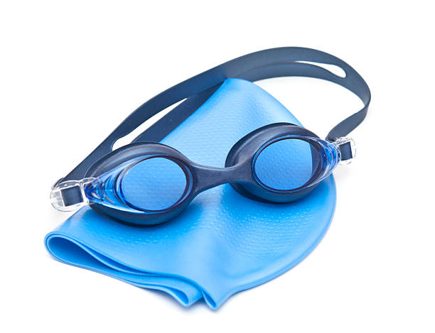 Blue swimming cap and goggles stock photo