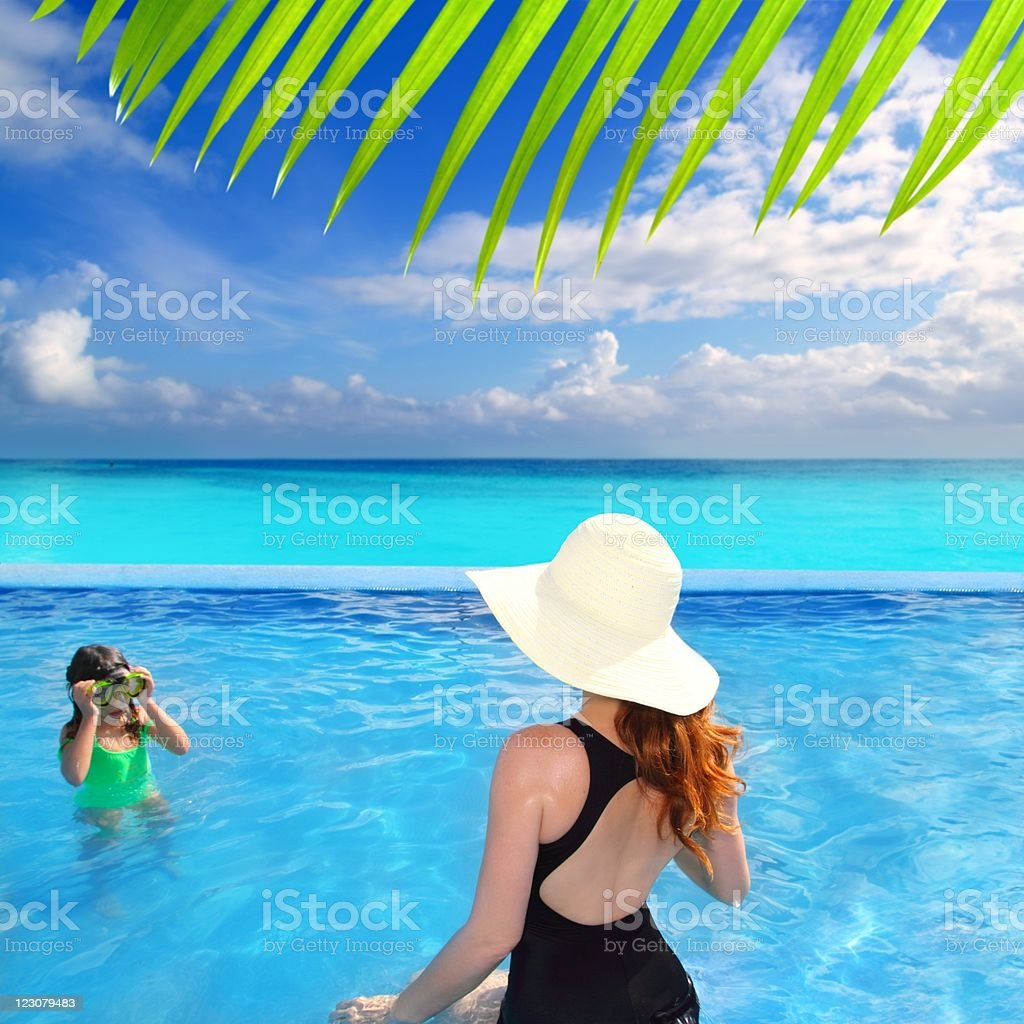 blue swimming pool caribbean view mother daughter royalty-free stock photo
