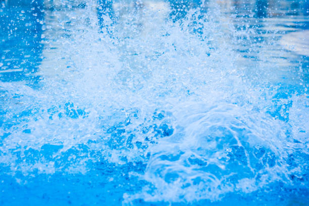 Blue swimming pool water splash stock photo