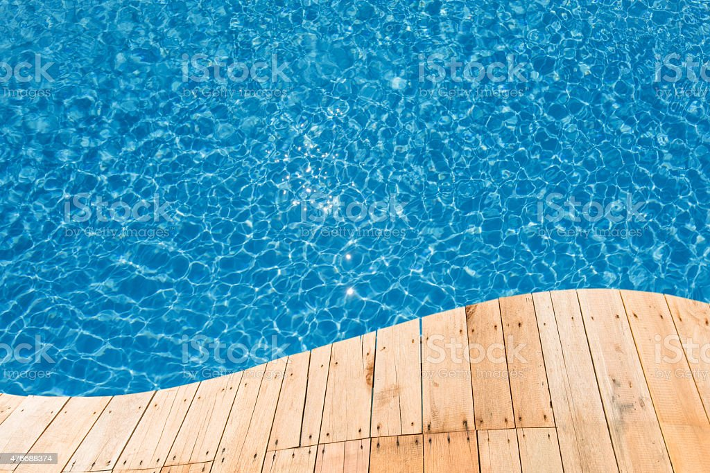 Blue swimming pool with a plank curve stock photo