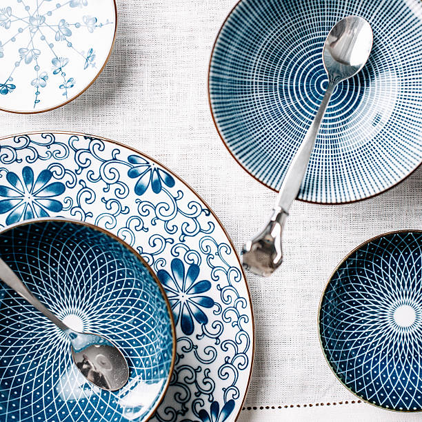 blue table ware plates and bowls overhead - crockery stock photos and pictures