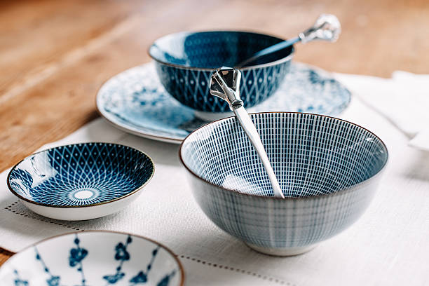 blue table ware plates and bowls - blue table setting stock photos and pictures